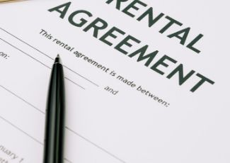 A pen and a rental agreement