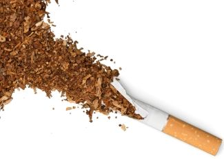Tobacco spilling out of a split cigarette