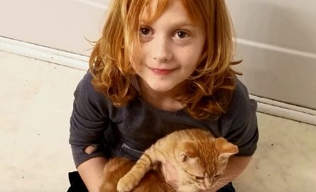 Young, red-headed boy with long hair